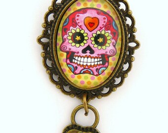 Vintage brooch Mexican skull on yellow background