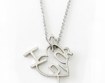 CHRISTIAN DIOR Vintage Dior Heart and Arrow Necklace Pendant in Silver tone