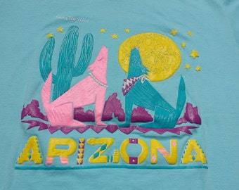 Beautiful Deadstock 90's Sun City West, Arizona Colourful Neon Bright baby blue teal t-shirt Made in USA