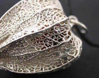 Elecrtroformed physalis pendant with cornelian bead