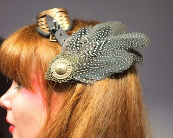 Speckled feathered hair clip accessory of hairstyle chic elegant evening wedding medieval pagan steampunk costume