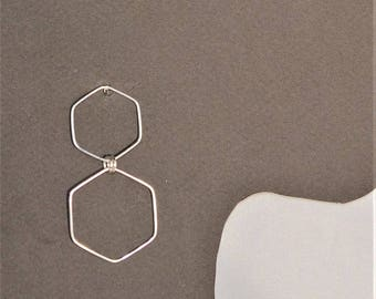 Earrings in silver formed by two hexagons