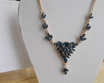 Blue and Clear Crystal Pendant Necklace on a Gold Tone Chain