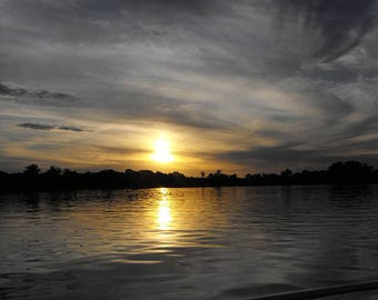 Dark Swirling Clouds and Setting Sun Reflected in the River - Sunset on the Water - Reflections at the End of the Day Photo Print
