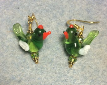 Translucent olive green, white and red lampwork songbird bead dangle earrings adorned with olive green Chinese crystal beads.