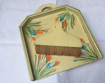 A pretty hand painted wooden crumb pan and brush.