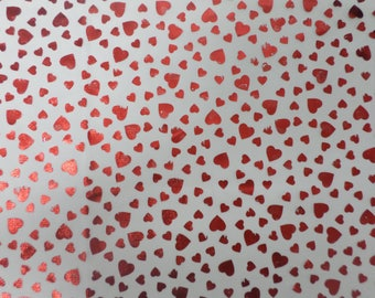 White see thru fabric with red Metalic or foil  hearts that is 3 yards by 44 inches wide and is perfect for Valenstines Day.