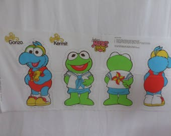 The muppet babies baby gonzo and baby kermit fabric panel to sew that is vintage and is from 1985. This panel is very rare and out of print.