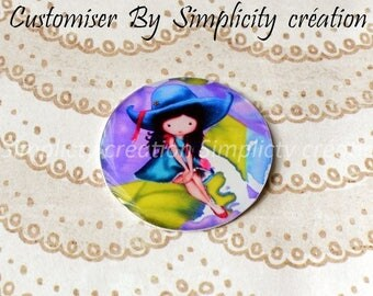 Digital image on a blue green 25mm resin cabochon