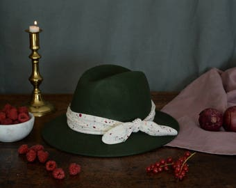 Khaki fedora hat decorated with a cotton scarf