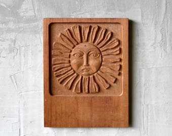 Evelyn Ackerman Sun Carving.