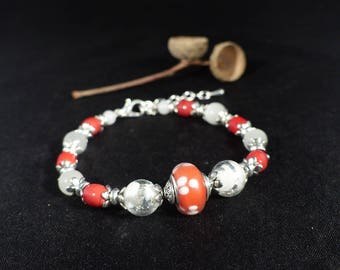 Bracelet ~ the dots are red. Bracelet red and white beads.