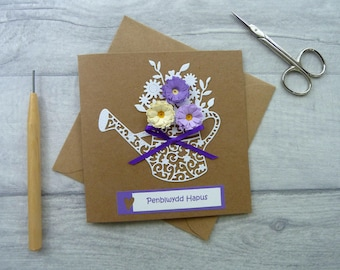 "Welsh Birthday Card with Quilled Flowers and Lacy Watering Can ""Penblwydd Hapus!"" Size 13.5cm x 13.5cm"