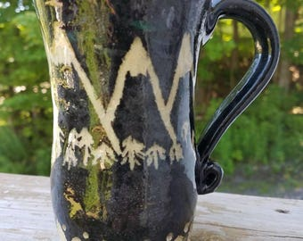 Handmade black carved mountain mug