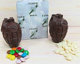 Valentines Chocolate, two milk chocolate grenades, 'smarties' and white chocolate buttons filling.