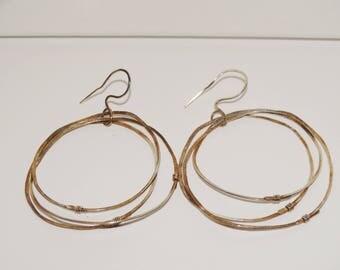 Sterling Silver Triple Hoop Earrings.