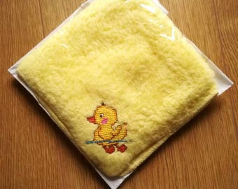 Yellow baby flannel with cross stitched duck