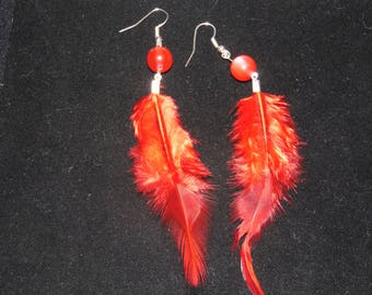 Pearl Earrings and Red Feather