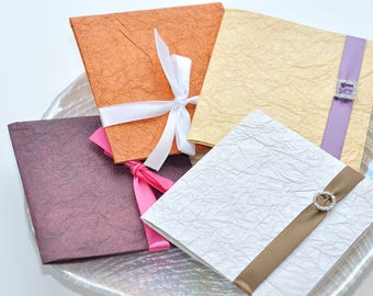 CD case with handmade paper - no ribbons or rhinestone buckles. Set of 10