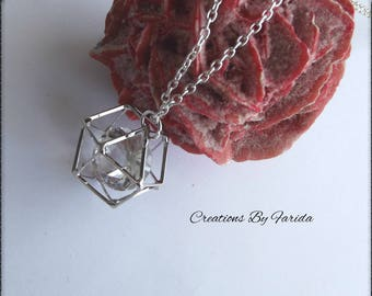 Necklace featuring a hexagonal cage pendant, with a Pearl shaped diamond
