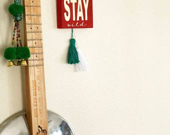 Stay Wild Wooden Sign With Tassels