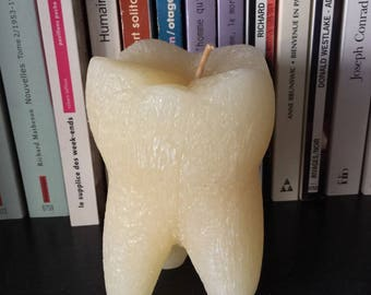 handcrafted in the shape of a molar candle