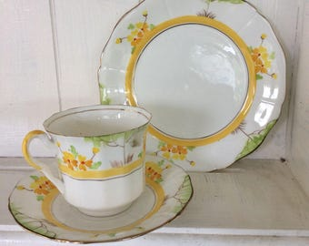 Vintage cup and saucer yellow flowers