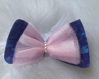 purple, pink, and blue fabric bow with pink tulle overlay with faux pearl center.