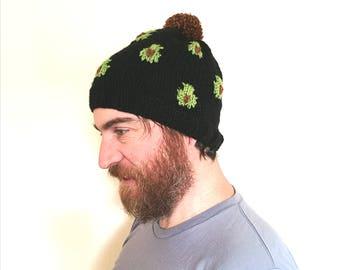 Avocado hat. Handmade chunky knit green and black bobble hat/beanie