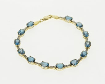 "14K Oval Swiss Blue Topaz Diamond Accent Tennis Bracelet 7"" Yellow Gold"