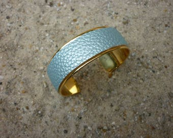 Metal bracelet with icy blue bangle cuff gold colored base