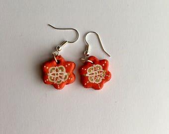 Handmade red flower shaped patterned earrings