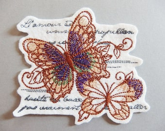 Applied on felt patch butterfly on writing