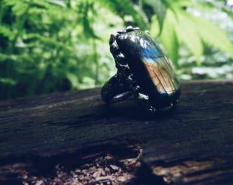 Beautiful magical ring with labradorite stone. Original design. Modern style. Magic averter. Amulet.