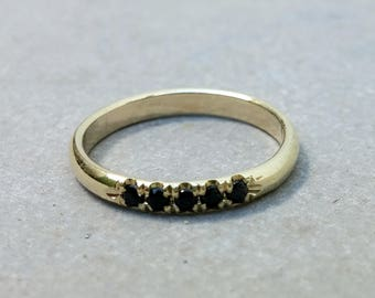 14K yellow gold half eternity ring with black onyx