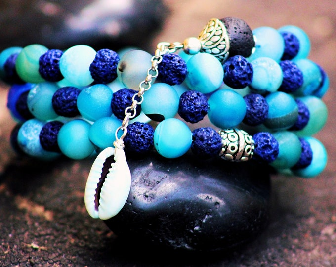 Blue cowrie charm bracelet.