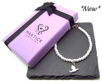 Faux pearl bracelet with silver dove charm
