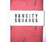 Mens pink pocket square with lightning print, with custom thread.