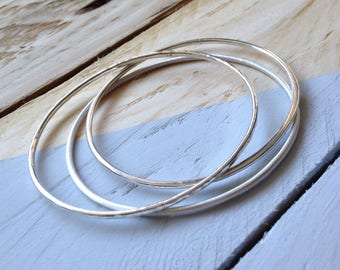 Trio of fine recycled sterling silver stacking bangles, beautiful handmade eco and ethical  jewellery gift.