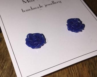 Dark blue rose studs.