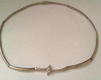 silver coloured choker