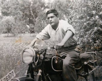 Vintage photo of Man and his BMW Motorcycle