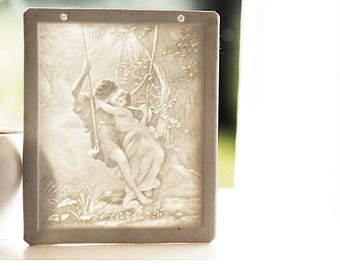 Antique porcelain lithopane panel ft. a neo-classical scene after the original painting of Pierre-Auguste Cot , c1910s.