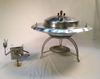 UFO spaceship with alien robot