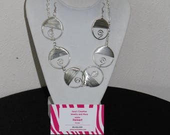 Two piece wire hoop necklace and earrings set.