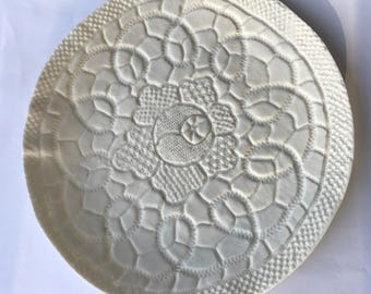 Lacy white textured porcelain (ceramic) dish