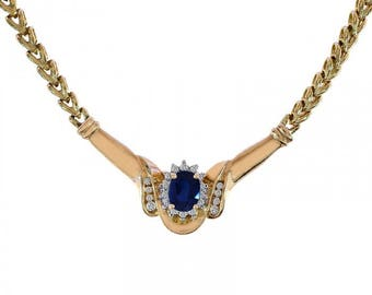 1.50 Carat Oval Cut Sapphire Necklace With 0.28 Carat Round Cut Diamonds 14K Yellow Gold