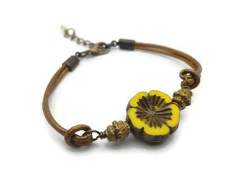 Yellow/brown glass flower and leather cord bracelet