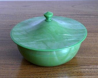 A Xylonite, Art Deco style green plastic trinket boxes, vanity