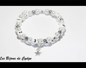 Nursing bracelet on memory wire form of 55mm with glass beads white and dark gray